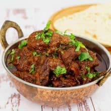 Indian lamb curry in a copper pot.
