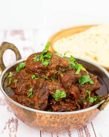 A bowl of lamb curry.