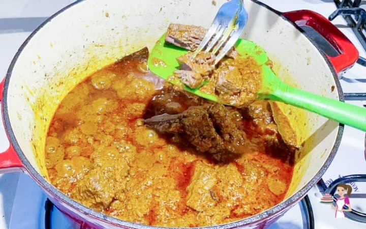 Cook the curry until the lamb is fork tender