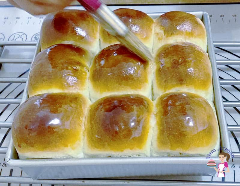 Brush the dinner rolls with butter