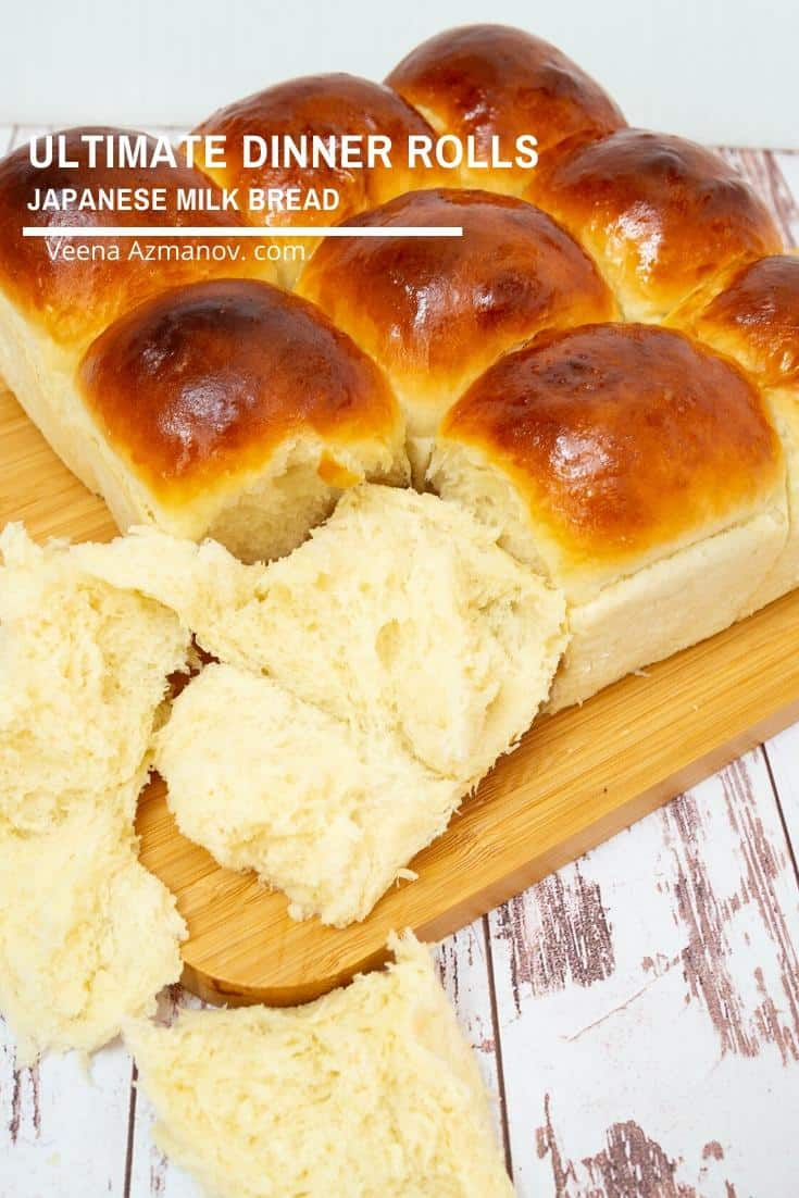 Japanese dinner rolls on a wooden board.