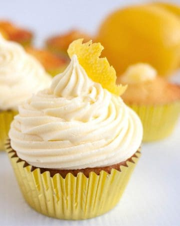 A cupcake with lemon curd and buttercream.