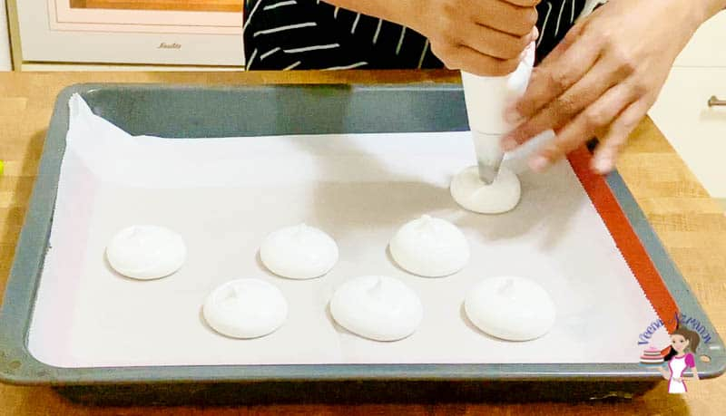 Pipe the meringue into dollops on the baking pan