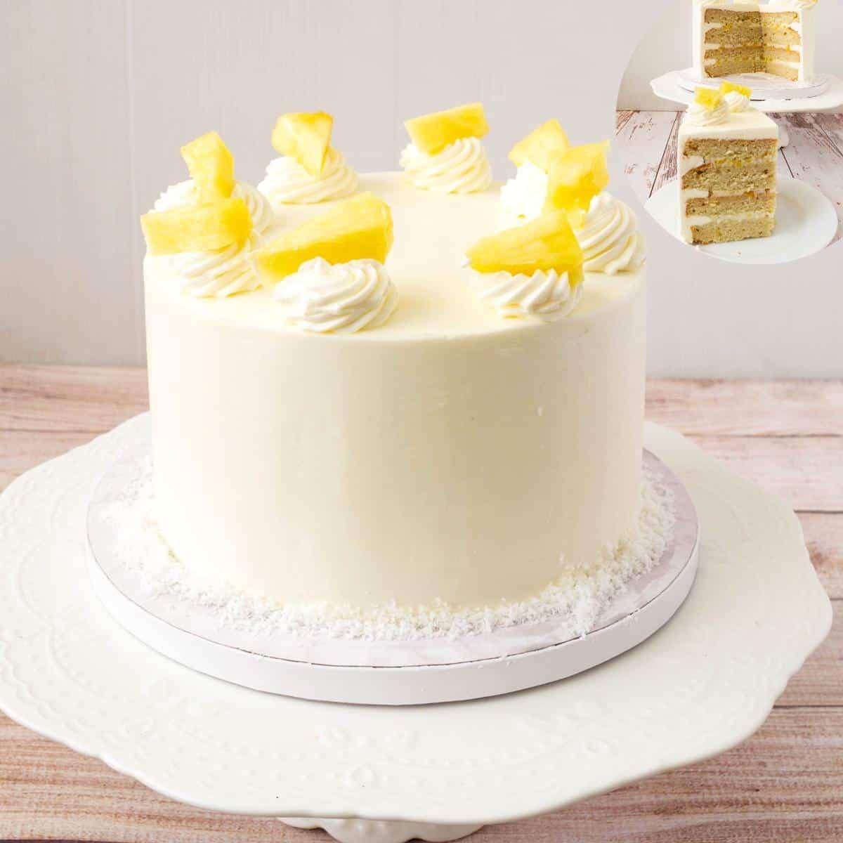A Pina colada cake on a cake stand.