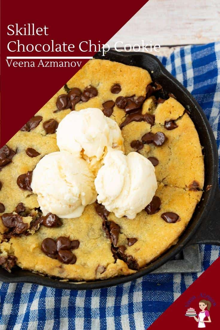 A giant chocolate chip cookie in a skillet, with ice cream on top.
