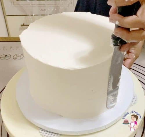 Smooth the sides of the cake with a spatula and bench scraper