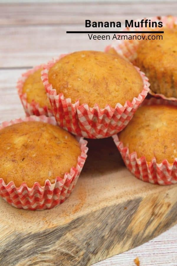 A stack of banana muffins on a wooden tray.