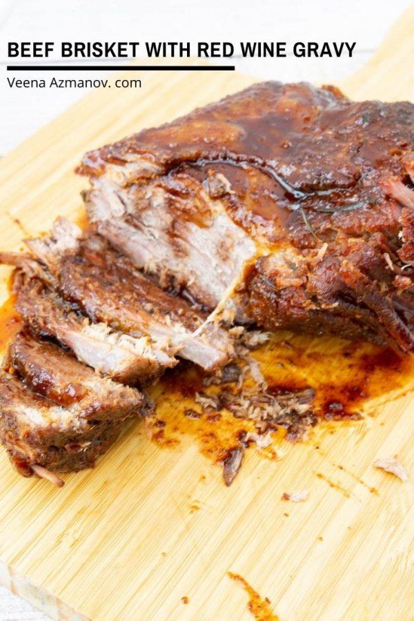 Sliced roast beef brisket on a wooden board.