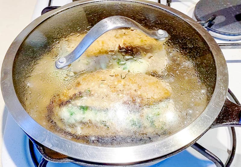 Cook the stuffed chicken breast on a skillet