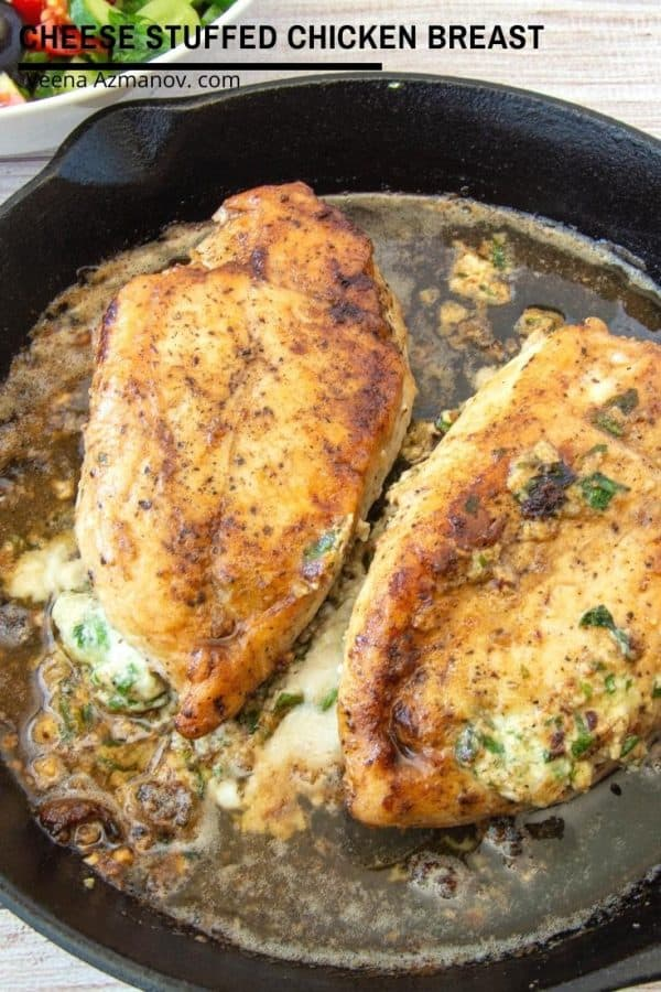 Two cheese-stuffed chicken breasts in a frying pan.
