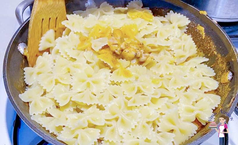 Add pasta to the enchilada chicken sauce