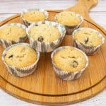 Chocolate chip banana muffins on a wooden board.