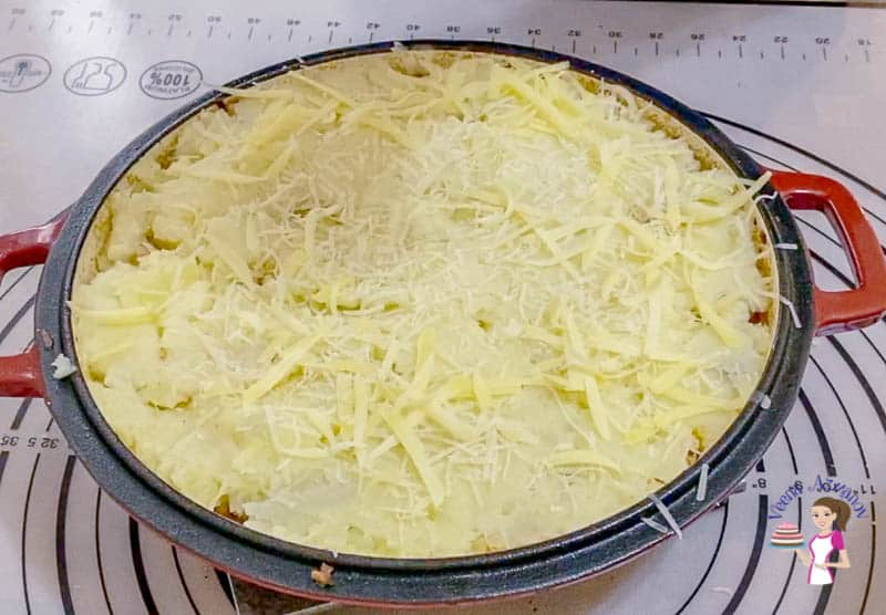 Top the mashed potatoes with cheese for the cottage pie