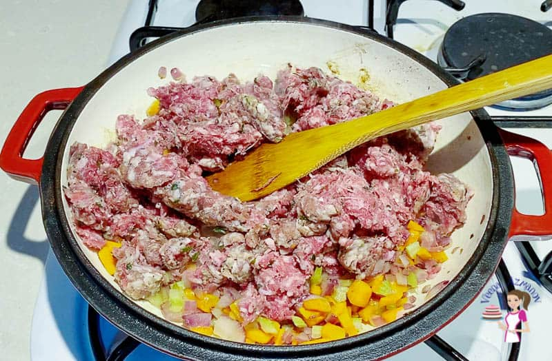 Saute the ground beef for the meat pie