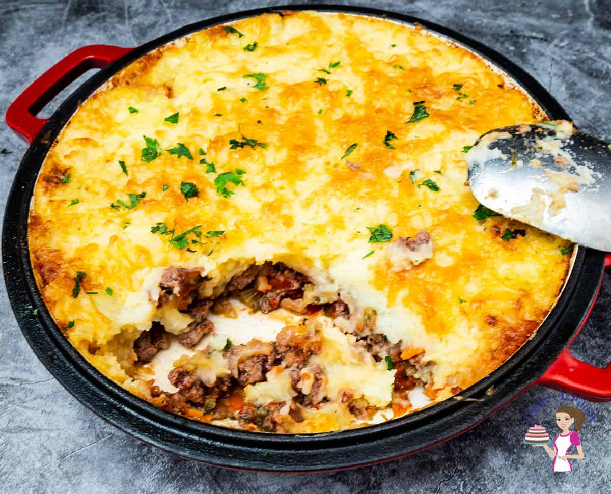 A skillet with ground beef with mashed potatoes.