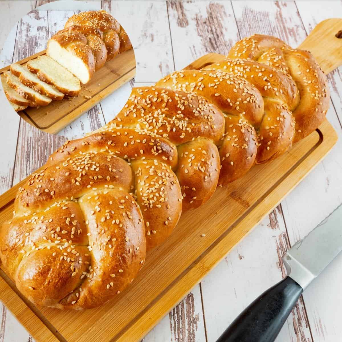 Five braided challah on a wooden board.