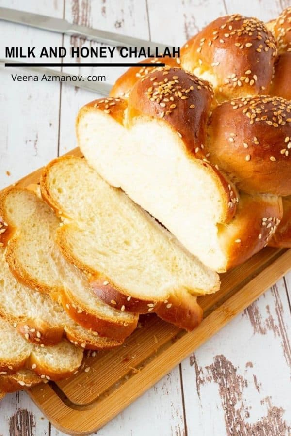 A sliced Challah Bread on a wooden board.