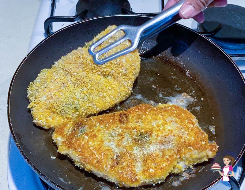 Pan fry the chicken breast on both sides until crisp and golden