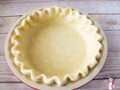 unbaked pie crust in a pie pan.