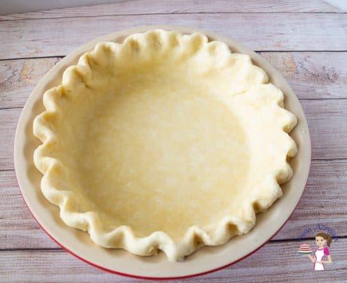 unbaked pie crust in a pie pan.