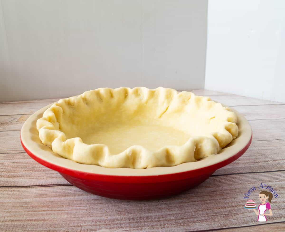 An unbaked pie crust in a pie pan.