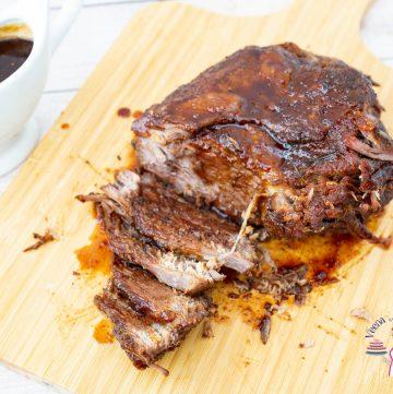 Beef brisket on a wooden board