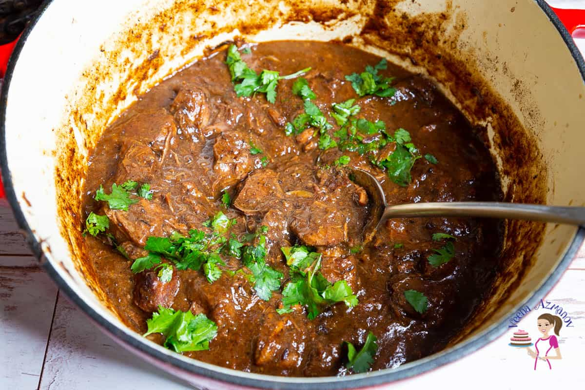 A pot with beef in red wine gravy.