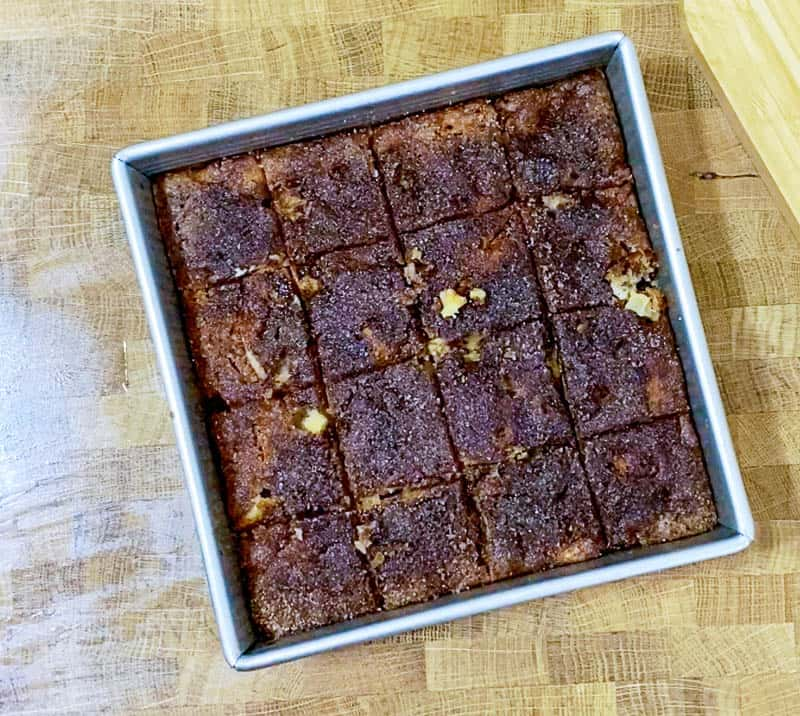 Slice the apple cake into 16 squares