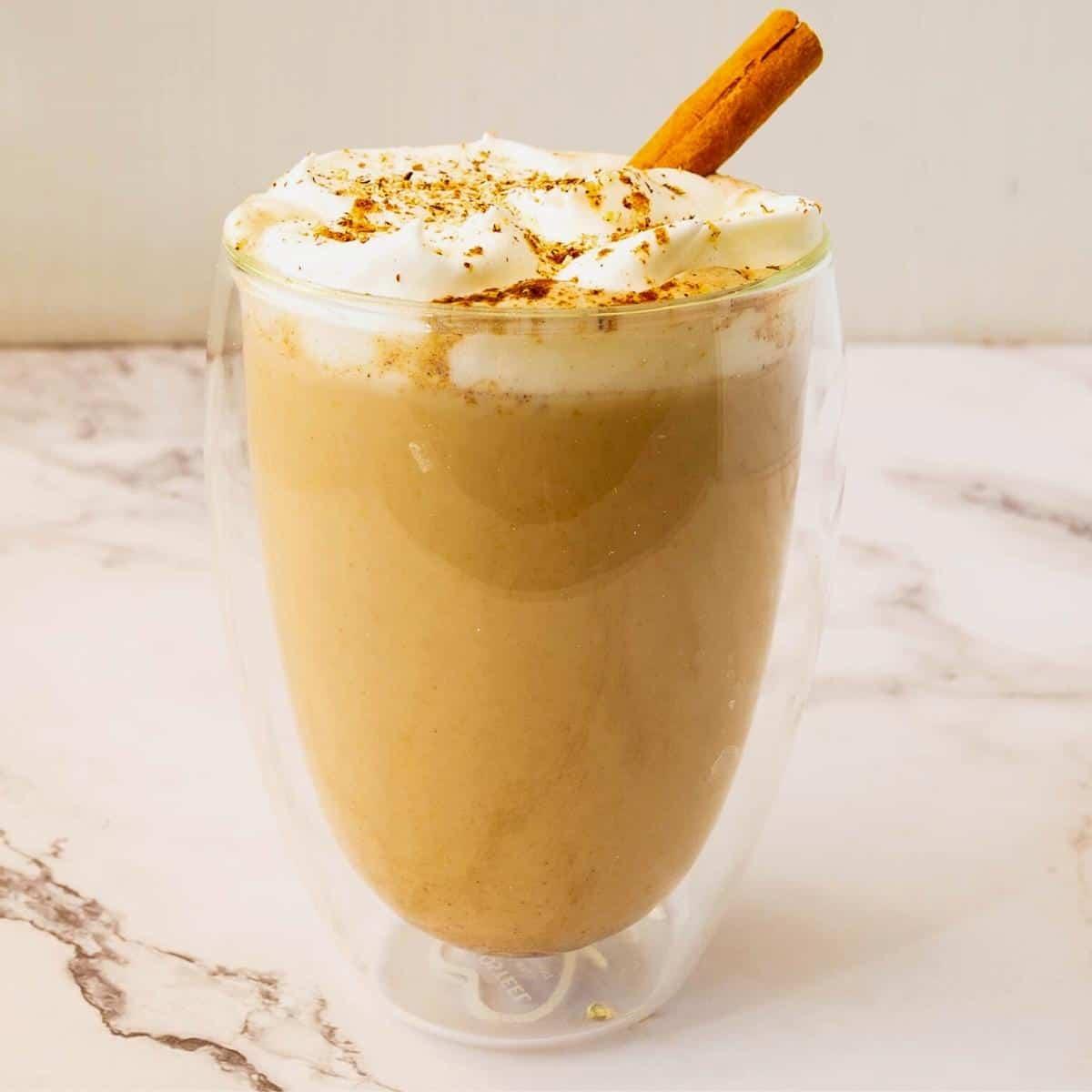Pumpkin latte in a glass.