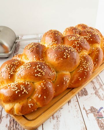 Challah bread on a wooden board.