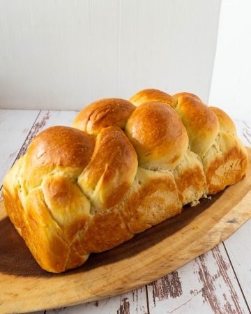 Challah bread on a wooden tray