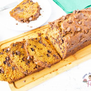 A Chocolate chip pumpkin bread on a wooden board