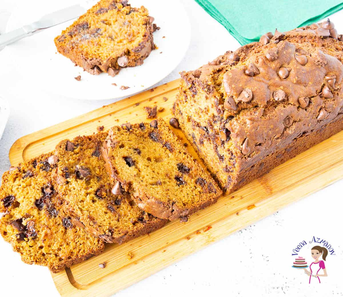 sliced chocolate chip pumpkin bread on a wooden board