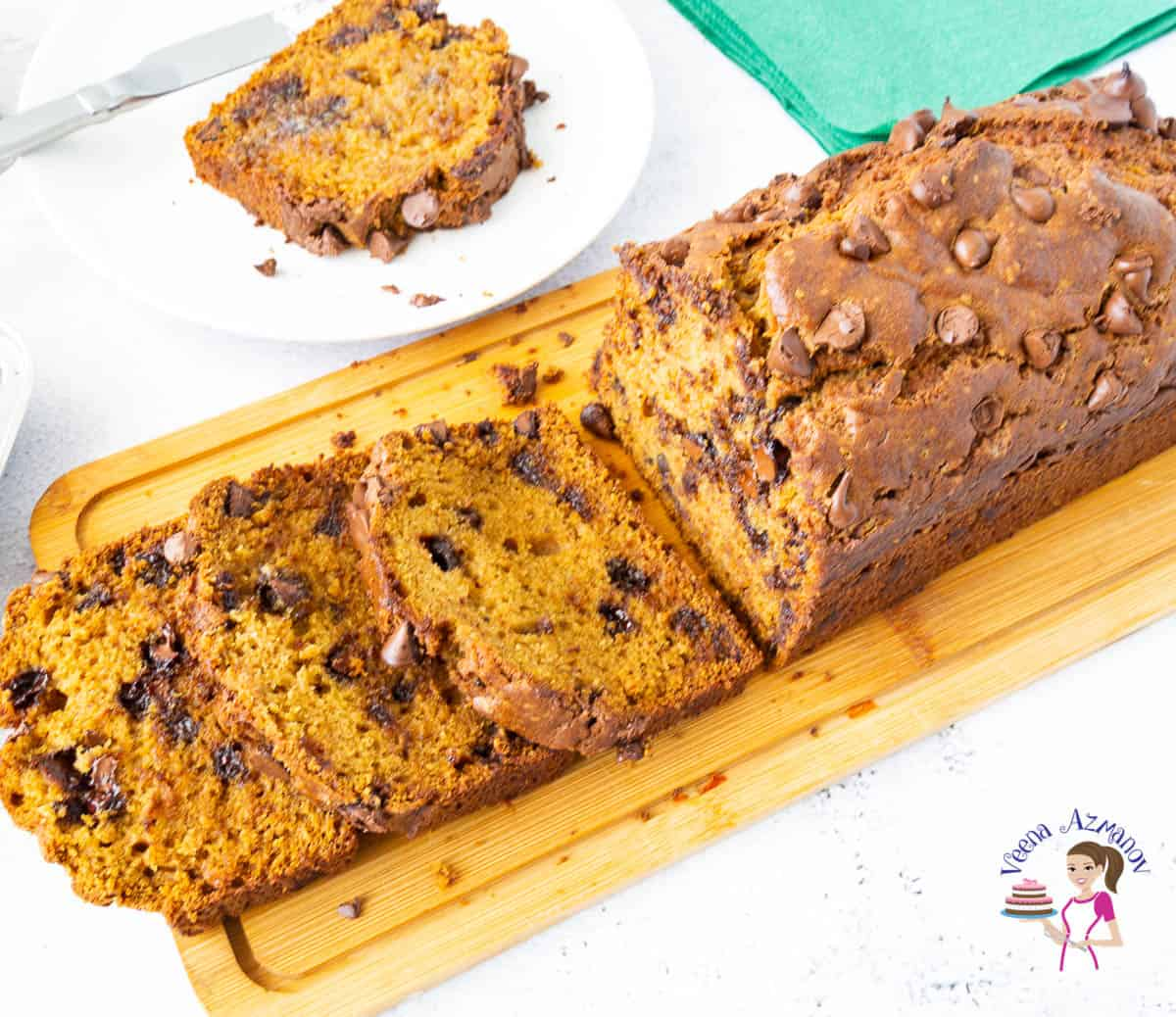 Chocolate chip pumpkin bread on a wooden board