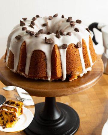 A glaze bundt cake on a cake stand.