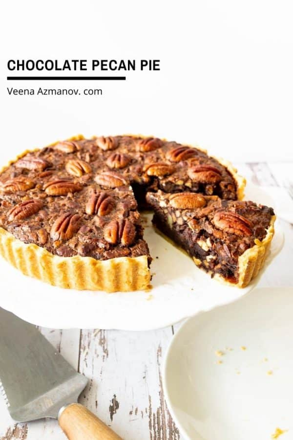 Pecan pie on a cake stand.
