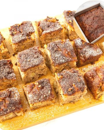 Cinnamon apple cake cut into squares.