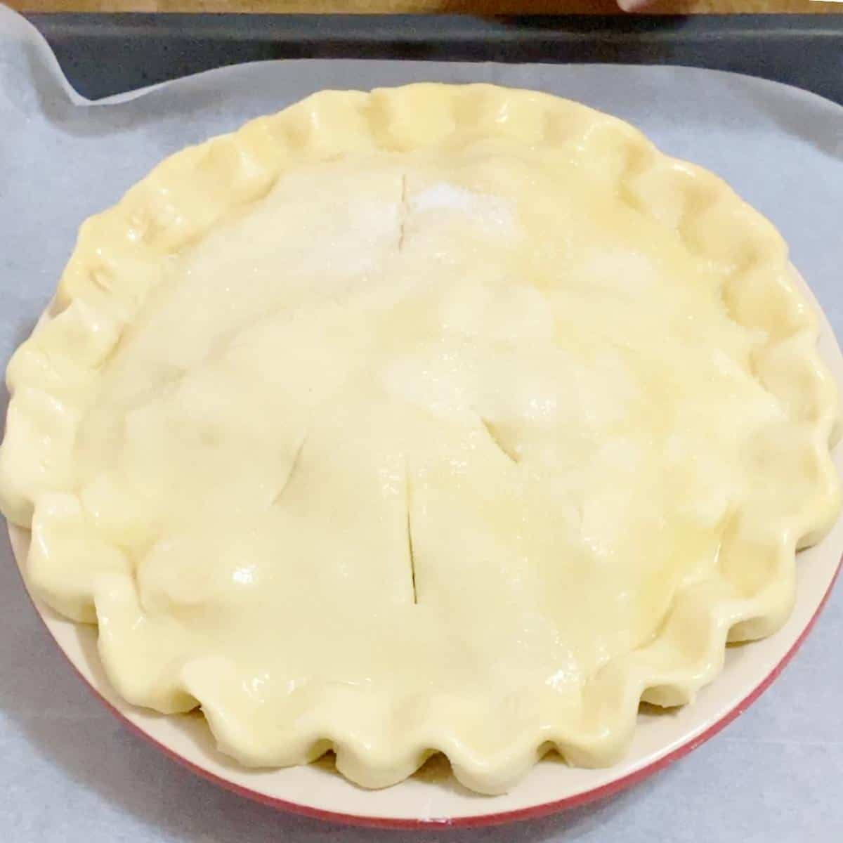 An apple pie with top and bottom all butter pie crust.