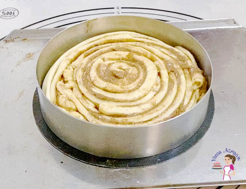 Place the giant cinnamon roll in the cake pan