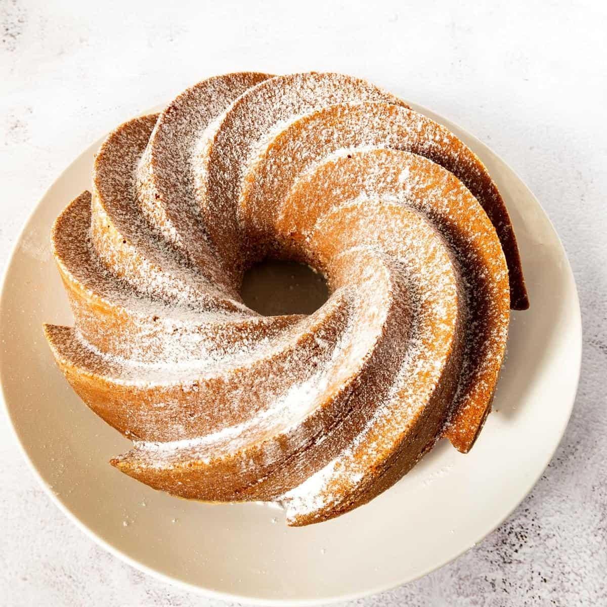 A bundt cake on a white plate.