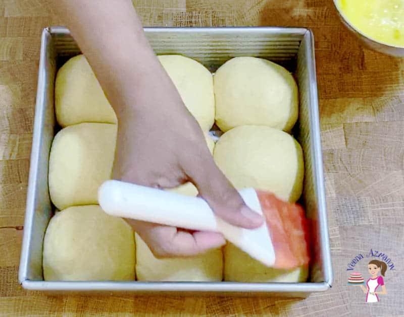 Egg wash the dinner rolls