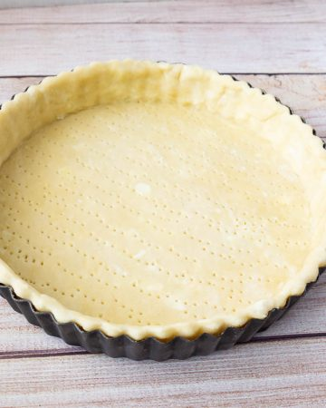 A pie crust in a pie pan.