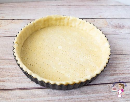 A pie crust in a pie pan.