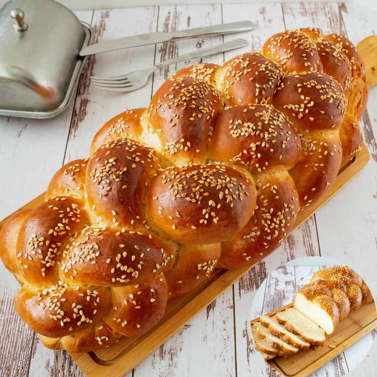 A six braid challah on wooden table.