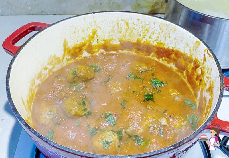 A bowl of meatballs in tomato sauce.