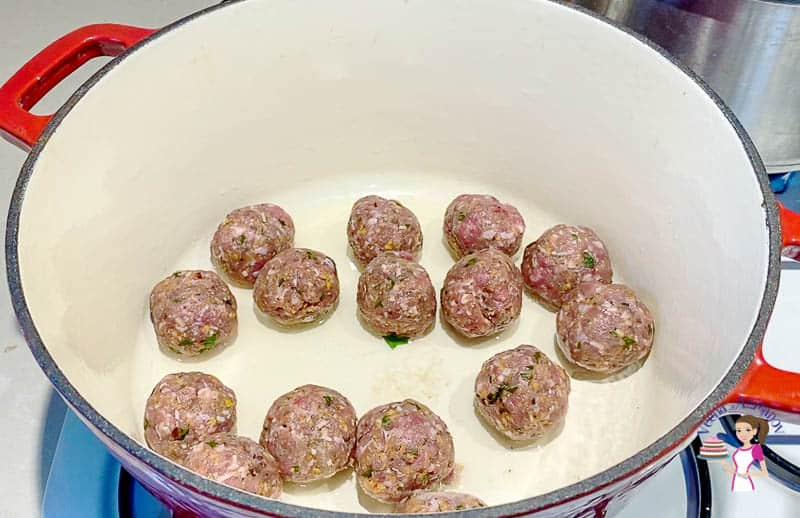 Sear the meatballs in oil on all sides