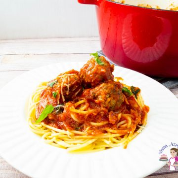 A plate of pasta bolognese with meatballs.