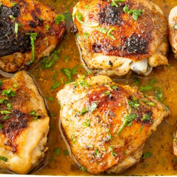 chicken thighs baked in a ceramic dish