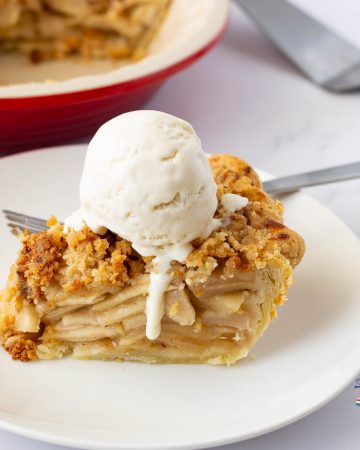 A plate of apple pie with vanilla ice cream
