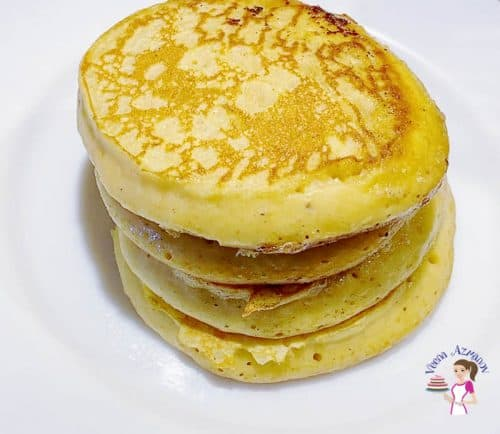 a stack on pancakes on a white plate